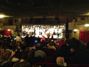 """Audience on stage at BWay's """"Once"""""""